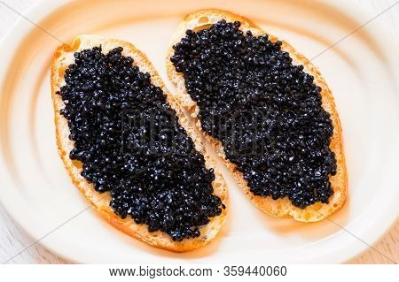 Sandwiches With Black Sturgeon Or Beluga Caviar Close Up
