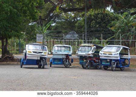 Palawan, Ph - Dec. 4: Tricycles Parked Outside On December 4, 2016 In Puerto Princesa, Palawan, Phil