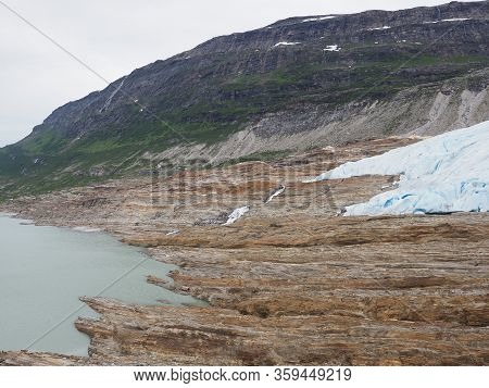 Austerdalsvatnet Lake Landscapes And Famous European Svartisen Glacier Tongue In Nordland County In