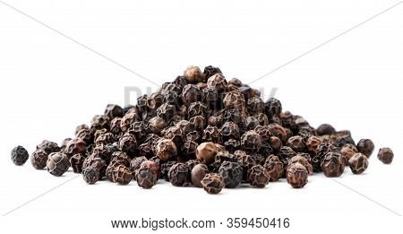 Pile Of Black Pepper Peas Close-up On A White Background. Isolated
