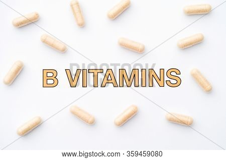 The Words B Vitamins And Some Pills Around It. Close Up.