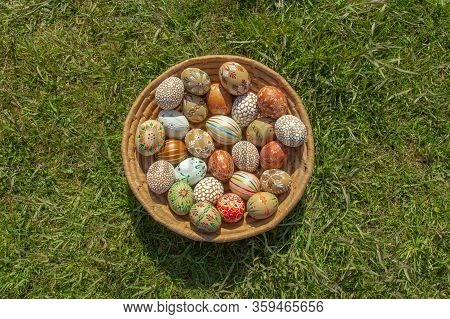 Full Background Of Colorful, Hand Painted Easter Eggs. Easter Eggs In A Wooden Basket.spring Decorat