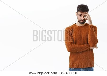 Portrait Of Awkward And Embarrassed Bearded Man Pretend He Not See His Ex, Hiding Face Behind Hand,