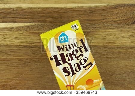Zaandam, The Netherlands - April 4, 2020: Package Of White Chocolate Sprinkles Against A Wooden Back