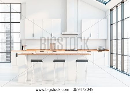 Interior Of Modern Panoramic Kitchen With White Walls, Wooden Floor, White Countertops And Cupboards