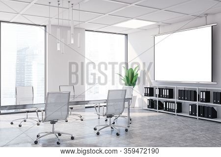 Interior Of Modern Meeting Room With White Walls, Concrete Floor, Long Conference Table With White C