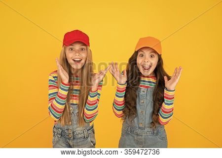 What A Surprise. Surprised Girls With Open Mouth In Surprise On Yellow Background. Happy Little Chil