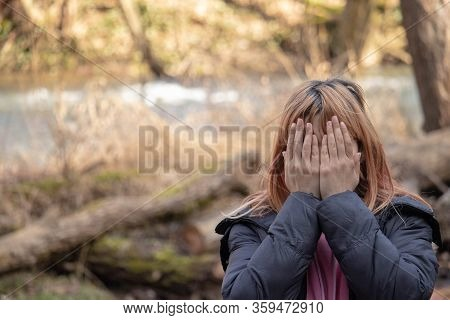 Girl Crying In Nature. Person In Agony Holding Hands On His Face. Depressed Young Woman In Shirt Hav