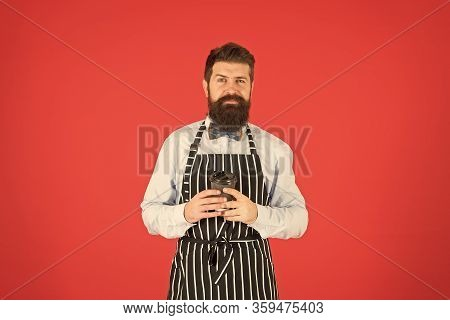 Bearded Man Hold Take Away Coffee. Brutal Waiter In Cafe. Mature Man Red Background. Skilled Servant