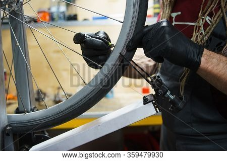 Workshop On Maintenance And Repair Of Bicycles. Details, Close-ups, Bicycle Maintenance Process. Han