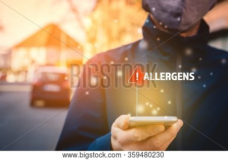 Increased Concentration Of Allergens And Polls In The Air. Man With Mask And Smart Phone With Notifi