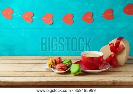 Happy Mother's Day Concept With Coffee Cup And Macaroons On Woooden Table