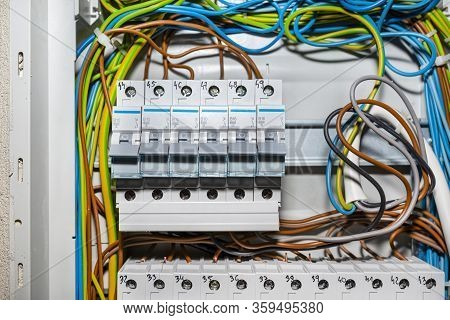 Single-phase Fuses In The Off Position, Placed In The Home Fuse Box, Visible Electric Wires.