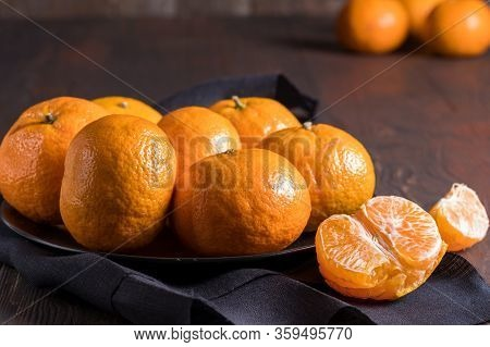 Fresh Mandarin Oranges Fruit Or Tangerines Over Wooden Background.
