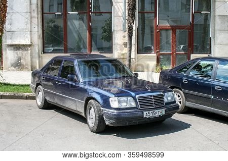 Suhkum, Abkhazia - July 29, 2009: Luxury Saloon Car Mercedes-benz W124 E-class In The City Street.