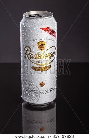 St. Petersburg, Russia, March 30, 2020. Radeberger Pilsner Beer, With Water Drops, Metal Can, On Bla