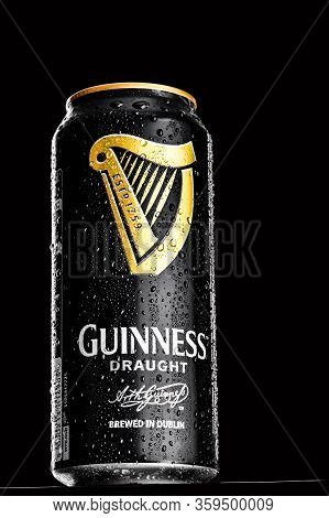 St. Petersburg, Russia, February 29, 2020. Guinness Draught In Tin Drink, On Black Isolated Backgrou