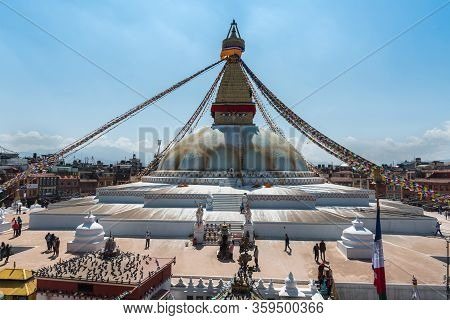 Kathmandu, Nepal - March 8 2020: Peope At The Famous Boudha Stupa, One Of The Largest Stupas In The