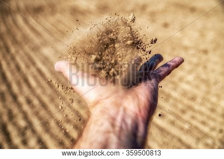 Dry Soil In Hand. Best Investment Cocncept