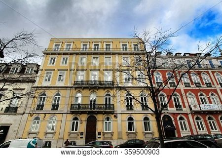Lisbon, Portugal- March 4, 2020: Old Colorful And Beautiful Majestic Facades With Vintage Streetligh