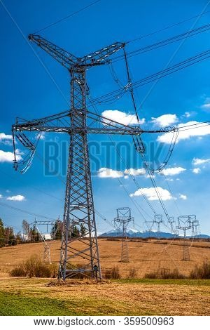 High Voltage Poles And Blue Sky. Energy Cocncept