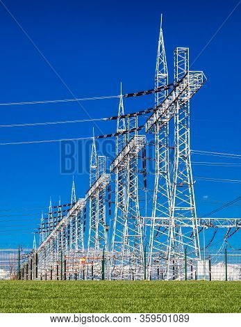 High Voltage Tower Power Line For Electricity And Blue Sky