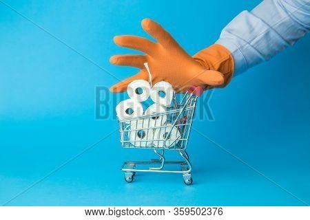 Hand In Protective Glove Grabbing Shopping Cart Full Of Toilet Paper Coronavirus Consumerism Minimal