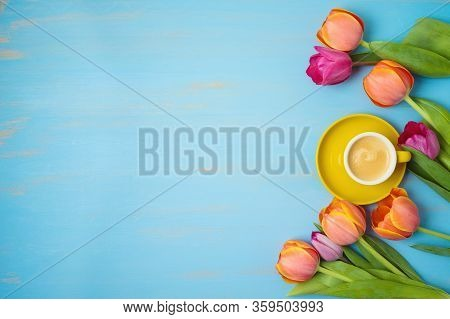 Happy Mother's Day Concept With Coffee Cup And Beautuful Tulip Flowers On Woooden Background. Top Vi