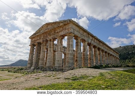 Ancient Doric Temple Of Segesta Which Is Under Reconstruction In Sunny Spring Day With Blue Sky And