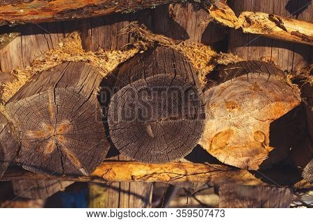 Old Aged Textured Woodpile In A Country House Background Wallpaper In Red Orange Yellow Warm Sunset