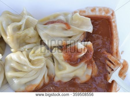 Closeup On Momo,  Traditional Indian Dumplings  - Steamed Cooked Momos With Tomato Sauce.- Served In