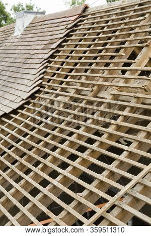 Replacing Old Tiles Reveals Failed Spreading Roof With Broken Rafters On A House In Uk