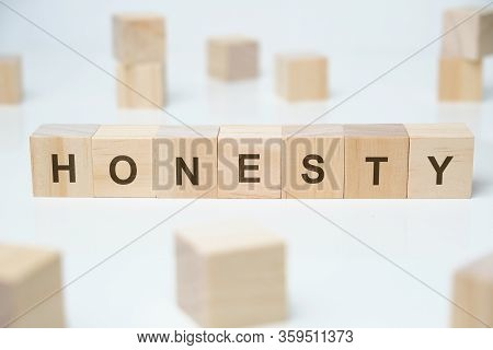 Modern Business Buzzword - Honesty. Word On Wooden Blocks On A White Background. Close Up.