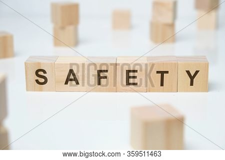 Modern Business Buzzword - Safety. Word On Wooden Blocks On A White Background. Close Up.