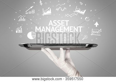 Waiter serving business idea concept with ASSET MANAGEMENT inscription