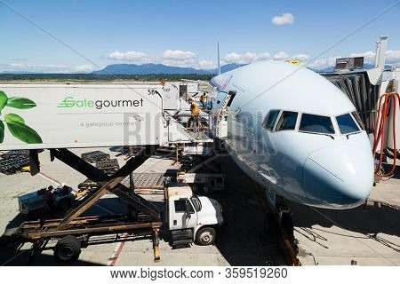Vancouver, Canada - July 3, 2017: A Ground Staff Prepares To Load Aircraft Meals From A Gate Gourmet