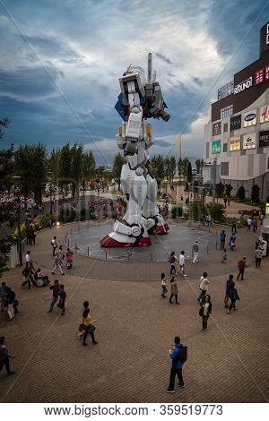 Tokyo, Japan; October 29 2014: Gundam, The Giant Tokyo Robot Surrounded By Many People In The Diver