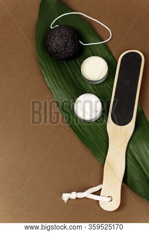 Palm Leaf With Natural Various Pumice For Exfoliating The Skin Lie On A Brown Background With Copy S
