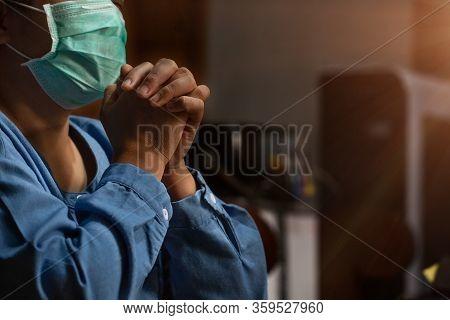 Asian Woman Wearing Medical Mask And Praying