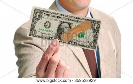 Businessman holding a dollar bill with medical band on economy financial crisis concept.