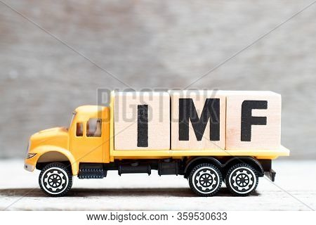 Truck Hold Letter Block In Word Imf (abbreviation Of International Monetary Fund) On Wood Background