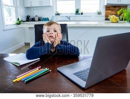 Coronavirus Outbreak. Lockdown And School Closures. School Boy With Face Mask Watching Online Educat