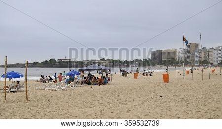 Rio De Janeiro, Brasil-  February 28, 2020: Citizens Swim And Sunbathe On The Beach Of Copacabana