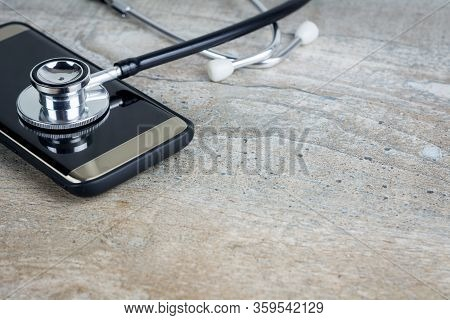 Phone Repair And Service Concept. Smartphone Being Diagnosed With A Stethoscope.