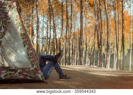 Relaxing Camping Tourism And Tent Under The View Pine Forest Landscape Near Water Outdoor In Morning
