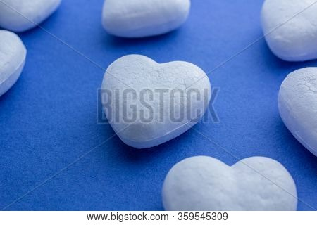 Artificial Love Concept, Frozen Heart. Valentines Day. White 3d Polystyrene Hearts Arranged In Rows