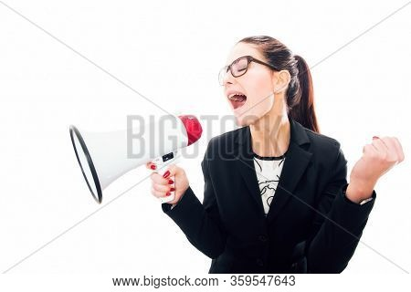 Young Businesswoman Yelling Through A Megaphone On Whiite