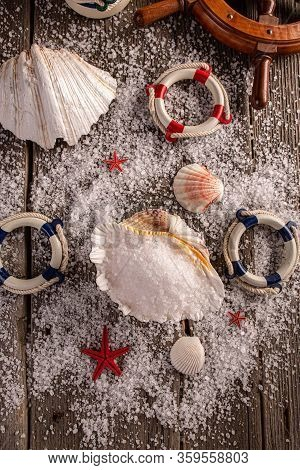 Sea Salt In Sea Shell On Wooden Background