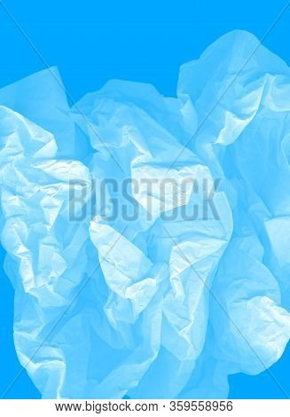 Airy Vertical Image. Blue Large Light Elegant Cloud Of Crumpled Paper On A Cyan Background. Crushed,