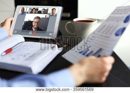 Business Woman Talking To Her Colleagues In Video Conference. Business Team Working From Home Using